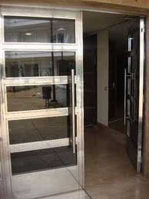 Puertas acero madrid cerrajer a rejas escaleras y - Chapas de acero inoxidable ...
